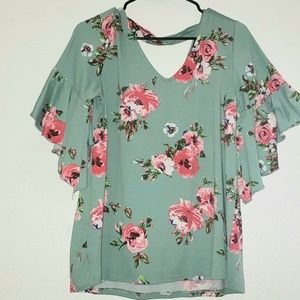 Seafoam green floral shirt.